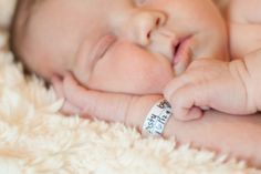 newborn photo with hospital bracelet & birthday