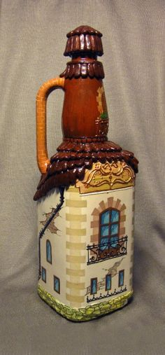 interesting treatment for a a bottle (Decorated Bottle House)