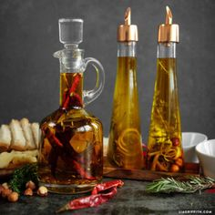 Learn how to create your own infused olive oil recipes to match your flavor preferences. Rosemary, lemon, dried chilies and thyme are all great for infusing Garlic Infused Olive Oil, Flavored Olive Oil, Infused Oils, Nut Granola Recipe, Olive Oil And Vinegar, Olive Oil Jam, Body Scrub Recipe, Herbalism, Homemade