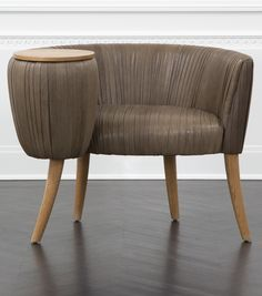 KELLY WEARSTLER | LEATHER SOUFFLE COCKTAIL CHAIR. Exquisitely detailed chair with a small, attached tabletop.
