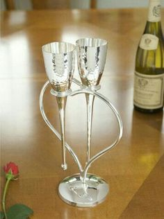 Entwining hearts champagne flutes.
