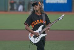 Strike One Kirk Hammett of Metallica performs during the SanFrancisco Giants 'Metallica Night' at AT&T Park in San Francisco, California on...