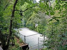 Private Tennis Courts surrounded by trees.