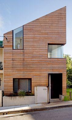 horizontal wood.  inset windows.