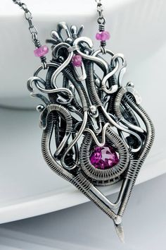 Sarah Thompson - Raspberry pink topaz, trillium cut. with pink sapphires in the chain. — Mina