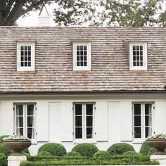 White on white with a parterre and great dormers. Renovation by Jimmy Laughlin. Back in Memphis on the hunt. Please send recommendations! Traditional Architecture, House Design, Cottage Exterior, Exterior Brick, Exterior Design, House Designs Exterior, Exterior Renovation, House Paint Exterior, Shake Roof