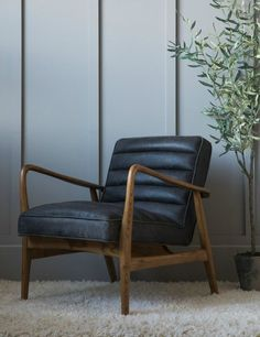MidCentury Leather Armchair Black is part of Mid century leather armchair - MidCentury Black Leather Armchair at Rose & Grey Buy online now from Rose & Grey, eclectic home accessories and stylish furniture for vintage and modern living Salon Mid-century, Black Leather Armchair, Leather Armchairs, Leather Recliner, White Leather, Retro Armchair, Wooden Armchair, Mid Century Sofa, Mid Century Leather Chair