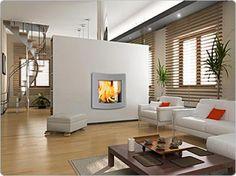Moderne Architektur in Höchstform und dazu der klassische Kamin als Kontrastmoment: Eine tolle Inszenierung des Feuers     repinned by aa-kaminwelt.de
