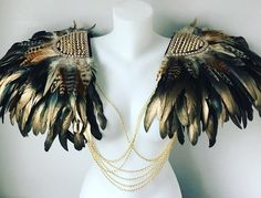 Photos courtesy of Make up Glitter art Glitterfreaks Director Black, natural and gold hand crafted feather wings/epaulettes with gold studded embellishment and diamante trim. Perfect for weddings, Mad Max, Burning Man, Hold Ups, Burlesque, Festivals, Area Codes, Glitter Art, Feather Crafts, Gold Feathers