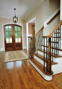 French doors and a wide staircase are focal points in this entryway with natural wood floors. We like the contrast of the natural wood and white of the ... & Small Foyer Lighting Ideas | Entryway - Lighting | Pinterest ...