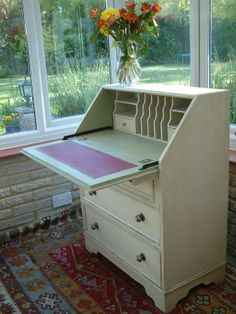 My writing desk looks like this but is rounder and also has brown veneer. Can be painted.