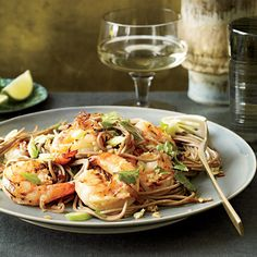Soba Noodles with Grilled Shrimp and Cilantro | Garlicky, spicy and bright with lime, this noodle dish is both warming and energizing, according to Thai tradition.
