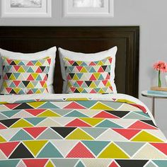 "Add a pop of pattern to your master suite or guest room with this eye-catching duvet cover, showcasing a multicolor geometric motif. Made in the USA.   Product: Duvet coverConstruction Material: PolyesterColor: MultiFeatures:  Designed by Heather Dutton for DENY DesignsConcealed zipper closureMade in the USA Dimensions: Twin: 63"" x 88""Queen: 83"" x 88""King: 100"" x 86""Cleaning and Care: Dry clean"