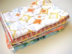 Burpies made with recycled t-shirt fabric on the back and quilting cotton fronts