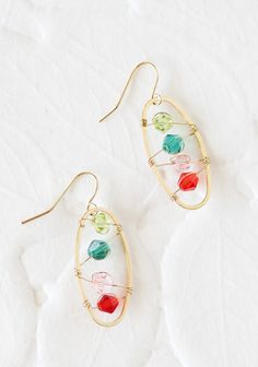 "Magic Moment Earrings 14.99 at shopruche.com. These adorable earrings are finished with gold wiring details and features lime, teal, pink and red crystal beading.1.25"" long"
