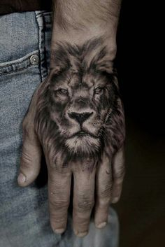 30 Best Of Hand Tattoo Ideas Tattoo Designs 10 Tiger Hand Tattoo, Lion Hand Tattoo Men, Tribal Lion Tattoo, Lion Tattoo Sleeves, Lion Head Tattoos, Hand Tats, Hand Tattoos For Guys, Best Sleeve Tattoos, Top Tattoos