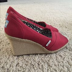 Red Toms Wedges Red Toms Wedges. In great shape. Only wore them a few times. Were not the right size for me. Wish they were - love the look! TOMS Shoes Wedges