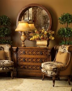 I love the mix of contemporary and antique finishes is this warm sitting room!