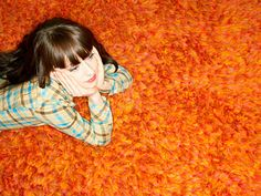 "Shag carpet...had this color in our basement.  Blue in my room and yellow in sisters' room!  Had to rake it with a ""rug rake""."