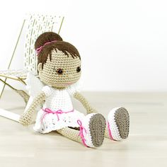 This written crochet pattern includes all the instructions needed to make your own angel doll.
