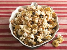 From Betty's Soul Food Collection.   this is a sweet and salty snack with popcorn, cinnamony cereal, peanuts and a sprinkle of coconut for good measure.