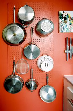 Kitchen idea: a pegboard wall for kitchen tools.  Click for more great kitchen storage solutions!