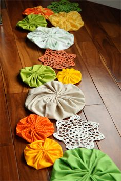 You could do any color combination or themes for this giant yo-yo garland and/or table runner.