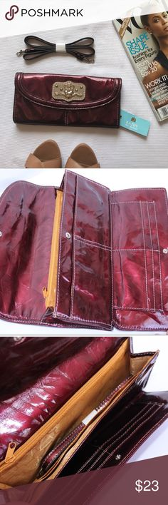 Kathy Van Zeeland Clutch/ Cross body NWT. Versatile Clutch in a beautiful burgundy color.  Comes with straps that are detachable. You can wear over the shoulder or as a crossbody Clutch. It's brand new with tags still attached. I'm open to offers. Don't forget to bundle and Save!! *** see last 2 photos** they got a few Knicks from being stored away. Kathy Van Zeeland Bags Clutches & Wristlets