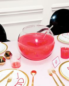 Orblike punch bowls dotting tables aren't just inviting centerpieces; they're cost-effective and efficient, and the display acts as a serve-yourself cocktail station that eliminates bar bottlenecks. Contributing editor Peter Callahan, of Peter Callahan Catering in New York City, developed the rum and pink-grapefruit tipple that's kept cool with an oversize (thus slow-melting) ice cube.