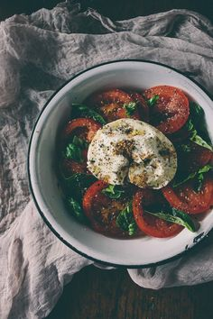 This burrata caprese salad is the perfect plate of summer. Fresh plump tomatoes drizzled with olive oil, balsamic vinegar and served with fresh burrata cheese and basil.