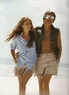 Photo of Ricky and Ralph Lauren walking on the beach in Amagansett, Long Island, 1977 by Les Goldberg