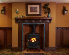 Art tiles surround a salvaged stove in the basement fireplace. Fireplace Tile, Craftsman Fireplace, Craftsman Interior, Dutch Colonial Homes, Home Crafts, Home Art, Arts And Crafts House, Fireplace Surrounds, Colonial House