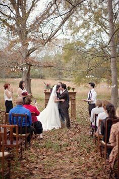 fireplace frame/mantel as wedding alter... Outdoor, in the fall, leaves on the ground, mantel as alter, old-fashioned wooden chairs, candles hanging from trees... i