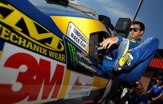 Chase Elliott Photos Photos - Chase Elliott, driver of the #24 NAPA Chevrolet, gets into his car during qualifying for the Monster Energy NASCAR Cup Series Auto Club 400 at Auto Club Speedway on March 24, 2017 in Fontana, California. - Auto Club Speedway - Day 1