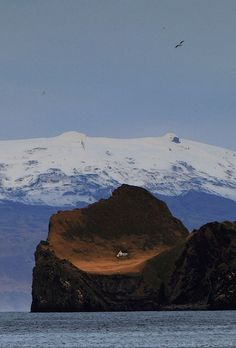 One of the Westman Islands and Eyjafjallajökull glacier in the back (by Sverrir Thorolfsson)