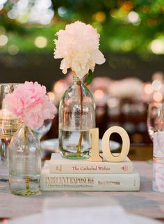 book centerpieces for that vintage love story theme! Love this one: Style Me Pretty  book centerpiece