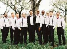 great groom style | groom in black suite and bowtie, groomsmen in black pants, shirt and suspenders, no jacket  | bright bowtie | Photography: Brett Heidebrecht - www.brettheidebrecht.com