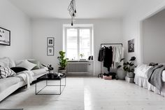 Light Scandinavian studio apartment with bed alcove