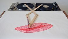 The Turntable Drawing Machine (click through to see video). It's like a Spirograph for grown-up kids.