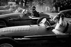 Silverstone, July 1953: Hawthorne lines up on the grid for the British Grand Prix after qualifying third. Pole sitter Alberto Ascari (Ferrari) is on the far side, then Jose Froilan Gonzalez (Maserati), Hawthorn (Ferrari) and Juan Manuel Fangio (Maserati).