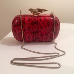 """DVF Flirty Lips Minaudière in Red Snakeskin Optional chain shoulder strap. Internal slip pocket. Signature lip clasp closure. Dust bag included. This bag is BRAND New, never used received it as a gift. Approx. 4""""H x 6.5""""W x 2""""D please make an offer!! Diane von Furstenberg Bags Clutches & Wristlets"""