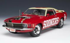 Highway 61 / DCP Oklahoma Sooners Football 1970 Ford Mustang Diecast 1:18 - Gift Item by Highway 61 / DCP. $64.99. Officially Licensed Product. Open hood, doors and trunk. 1:18 Scale Diecast Car. Front and rear suspension. Working steering wheel. For 1970, the Ford Mustang Mach I underwent several changes. New front-end styling was the most notable, including simulated air intakes that replaced the 69's outboard headlights and a change in hood color from matte black to a black...