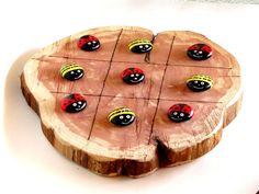 """Fun tic tac toe board made from cedar, approximately 10"""" across and 1/2"""" thick, all board sizes will vary. Each board comes with 10 hand painted rocks and the lines are burned in. These can totally be"""