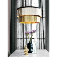 $279 Shop armour chandelier.   Glinty metallic fringe shimmers all around this two-tier, two-tone chandelier in a design that invites experimentation.