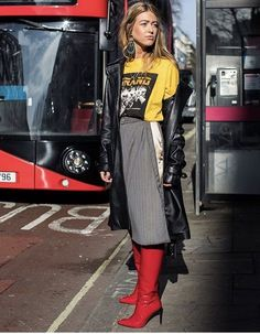 Streetstyle with leather trench and red stiletto tall boots. Graphic t shirt. See more at www.HerFashionedLife.com