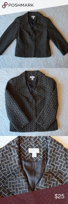 Ann Tyalor Loft brown blazer 4 Beautiful gently used Ann Taylor Loft Brown blazer with small white detail. 2 front flap pockets at hips. 3 Fabric snaps down front close the jacket. There is slight wear to one of the snaps fabric but doesn't not affect wear and is hardly noticeable. Brown lining. Shoulder pads. 66% cotton, 34% polyester. LOFT Jackets & Coats Blazers