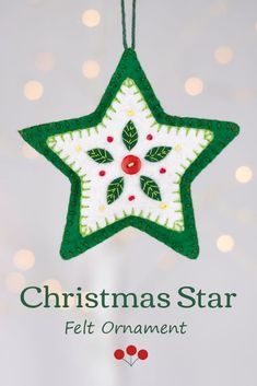 This hand stitched felt star has embroidered leaves and berries in green white and red, and is finished with a red button.The star has a loop for hanging and is 4 inches / 10cm high.;The price includes worldwide shipping. #feltchristmasornament #starornament Scandi Christmas, Christmas Star, Green Christmas, Embroidered Christmas Ornaments, Felt Christmas Ornaments, Felt Ornaments Patterns, Embroidered Leaves, Felt Tree, Felt Decorations