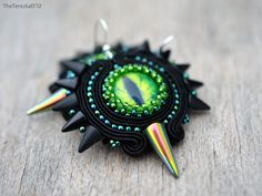 Soutache earrings with dragon eye cabochons and Czech spikes