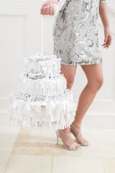 DIY Wedding Cake Pinata: http://www.stylemepretty.com/2015/03/31/diy-wedding-cake-pinata/ | Photography: Ruth Eileen - http://rutheileenphotography.com/