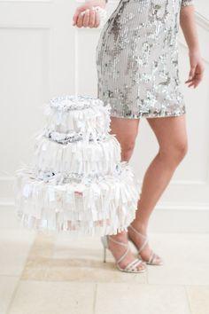DIY Wedding Cake Pinata: http://www.stylemepretty.com/2015/03/31/diy-wedding-cake-pinata/ | Photography: Ruth Eileen - http://rutheileenphotography.com/